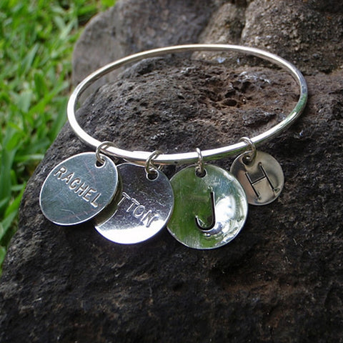 Silver Bangle with Engraved Disks