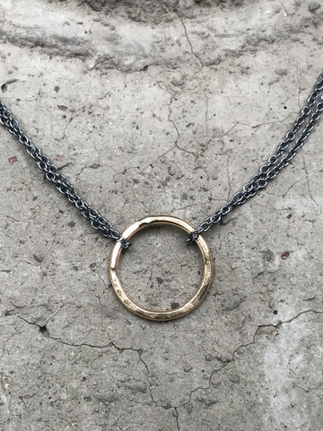 Gold Circle on Tarnished Chain