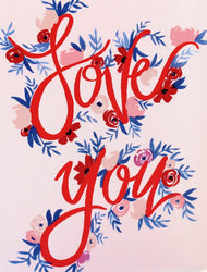 red love you hand lettered greeting card with pink, red and blue flowers, pink background, hand lettering