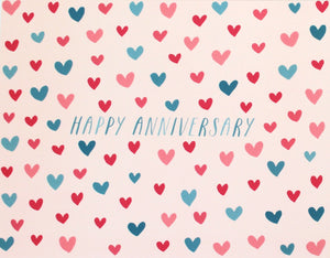 happy anniversary greeting card with blue and pink hearts pattern