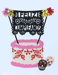 feliz cumpleanos happy birthday greeting card with papel picado bunting on pink and red icing cake with day of the dead skulls