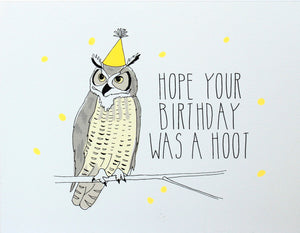 Great horned owl wearing neon yellow party hat,