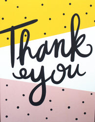 hand lettered thank you cursive on yellow and pink pop art background with polka dots
