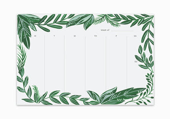 weekly planning notepad with green leaves