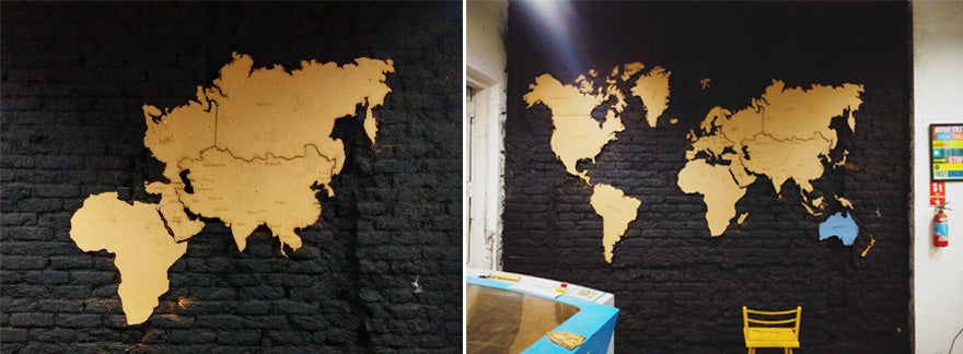 Laser Cut MDF World Map on Black Brick Wall