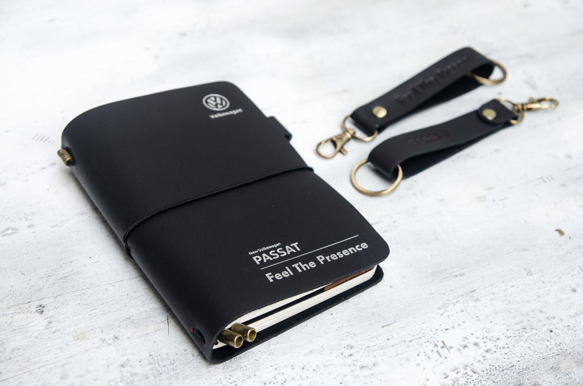 Volkswagen Passat black leather journal and keychain