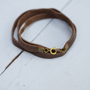 Leather wrist bands with antique hooks, open, brown, red, tan and blue