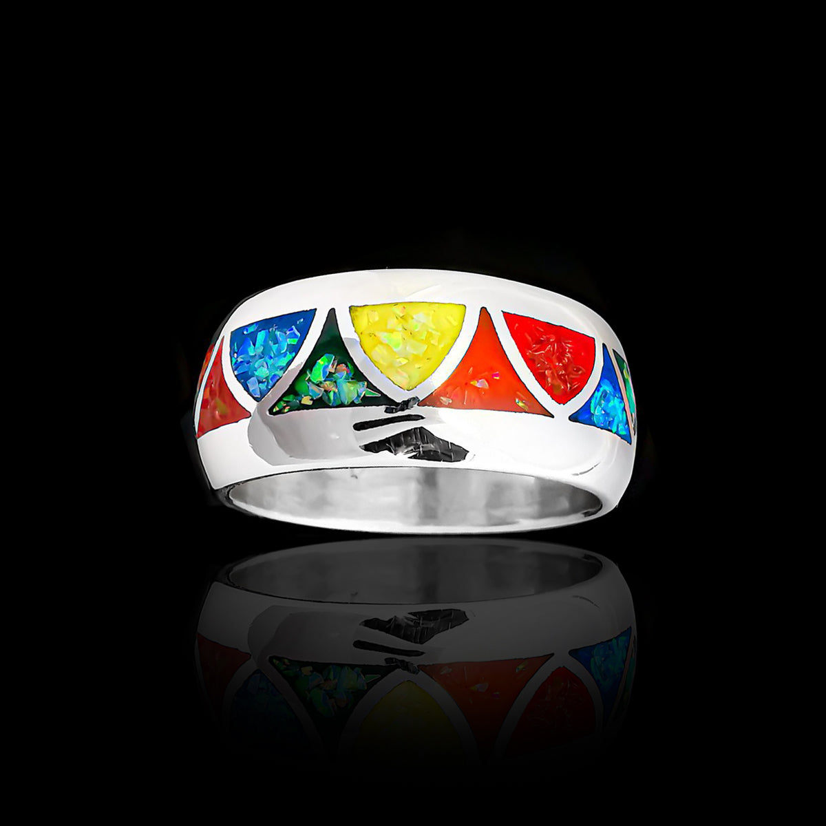 Wolvestuff's Wide Band Rainbow Pride Triangles Ring, handcrafted in sterling silver is inlaid with red, orange, yellow, green, and blue opals in a rainbow pattern