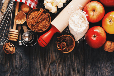 Ingredients for a baked apple on a wooden background