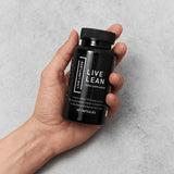 Live Lean pre workout capsules by Live Limitless in hand