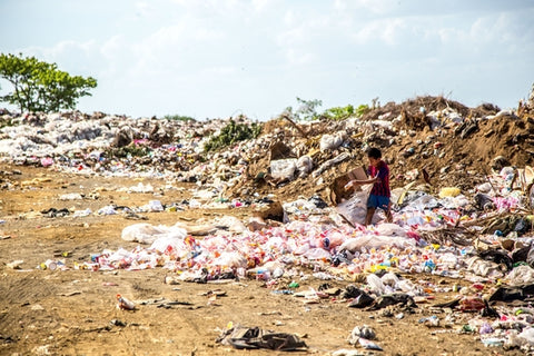 child in rubbish dump