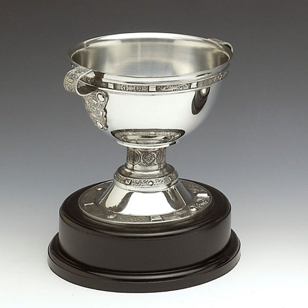 DERRY-NA-FLAN CHALICE REPLICA MOUNTED ON WOODEN BASE.