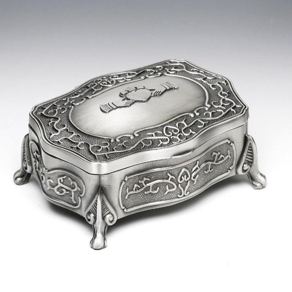 CLADDAGH JEWELLERY BOX WITH CELTIC SCROLL AND DELICATELY APPOINTED LEGS. The Pewter claddagh is fixed to the top of the box.