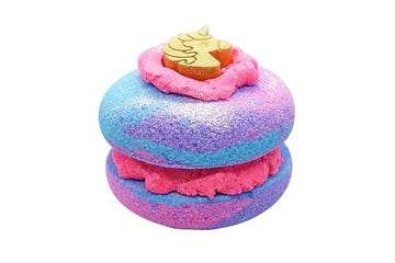 Pink, blue and purple donut bath bomb sandwich with pink bubble frosting and a gold unicorn soap on top.