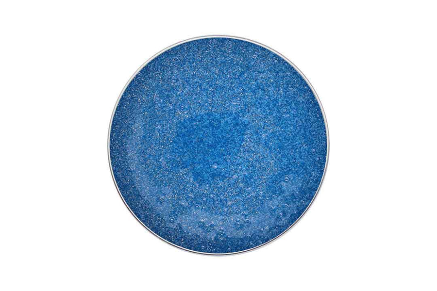 Birdseye view of a tin of blue glittery jelly soap.
