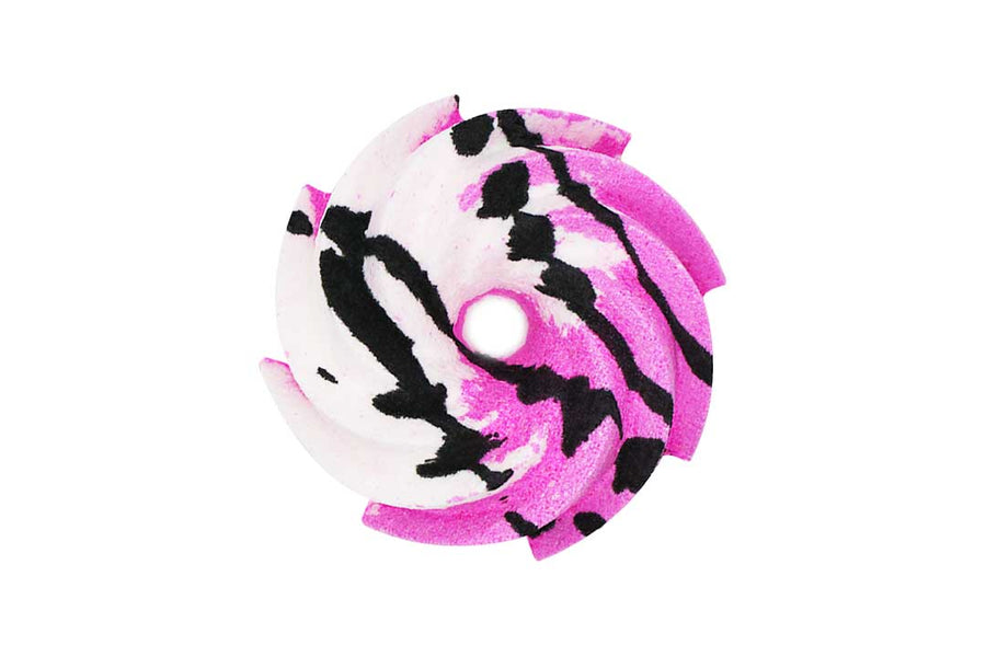 Pink and white swirl shaped bath bomb with black crumble on top.