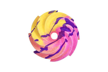 Yellow, pink and peach swirl shaped bath bomb with purple crumble on top.