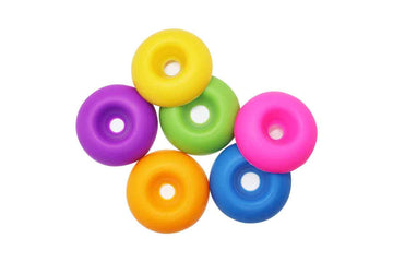 6 rainbow coloured donut shaped soy wax melts.