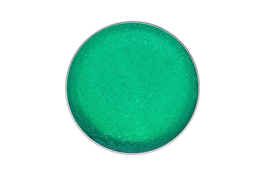 Birdseye view of a tin of green jelly soap.