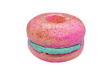 Pink donut bath bomb sandwich with aqua bubble frosting.