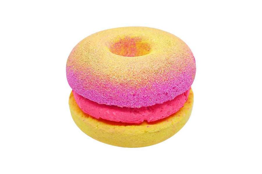 Pink and yellow donut sandwich bath bomb with pink bubble frosting.