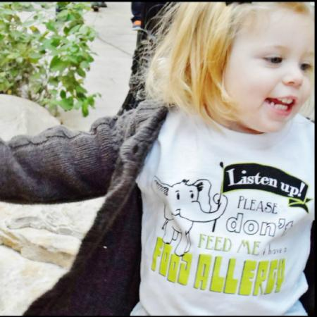 toddler in white elephant graphic tee