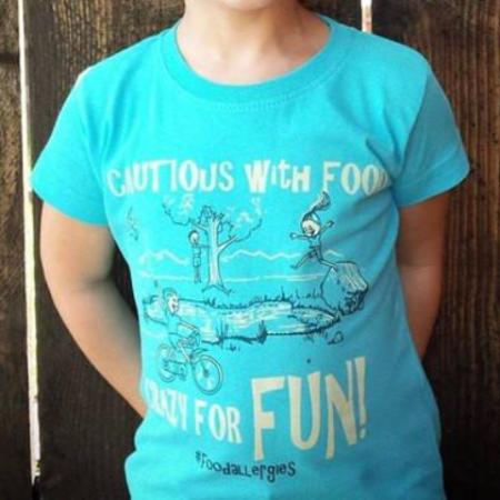 girl wearing blue side tie food allergy awareness tee