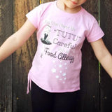 child wearing ballerina food allergy tee