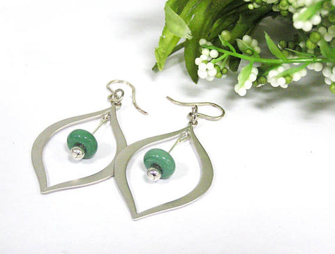 Green Teardrop Earrings--gorgeous, modern and perfect for spring fashion 2019! See them up close here https://wrist-flair.myshopify.com/collections/beaded-earrings/products/green-beaded-silver-teardrop-earrings
