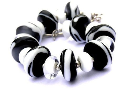 Black and White Zebra Print Bracelet--gorgeous handmade beads in a zebra print. Animal inspired and a little on the wild side! See it up close here https://wrist-flair.myshopify.com/collections/statement-bracelets/products/black-and-white-zebra-toggle-bracelet