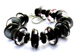 Black Glass Beaded Statement Bracelet--are you searching for modern yet timeless jewelry that is always in style yet makes a STATEMENT with your look? Check out this stunning black glass beaded toggle bracelet here https://wrist-flair.myshopify.com/collections/statement-bracelets/products/black-glass-beaded-bracelet
