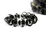 Black and Silver Toggle Bracelet--do you love finding neutral colored jewelry that works for your wardrobe all year long? I do too! You cannot go wrong choosing this stunning black glass beaded bracelet. Perfect for your next business meeting or night out on the town! See it up close by clicking here https://wrist-flair.myshopify.com/collections/statement-bracelets/products/black-glass-beaded-bracelet