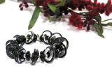 Black Beaded Toggle Bracelet--add some noticeable class and flair to complete your dressy look! This black bracelet features handmade glass beads and a silver toggle. See it up close here https://wrist-flair.myshopify.com/collections/statement-bracelets/products/black-glass-beaded-bracelet