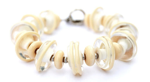 Off white glass beaded toggle bracelet--gorgeous, classy and makes a statement! See it up close by visiting https://wrist-flair.myshopify.com/collections/statement-bracelets/products/off-white-statement-bracelet