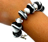 Unique one of a kind black and white beaded bracelet--Do you love animals AND love jewelry or know someone who does?? This black and white beaded toggle bracelet was inspired by zebras! If you're looking for a fun gift for someone who appreciates art, this is a perfect choice! Purchase it by clicking here https://wrist-flair.myshopify.com/collections/statement-bracelets/products/black-and-white-zebra-toggle-bracelet