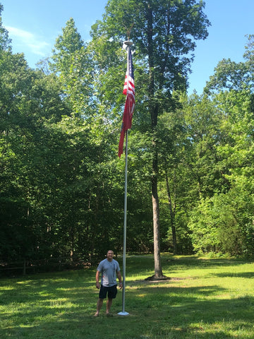 flagpole with customer in front