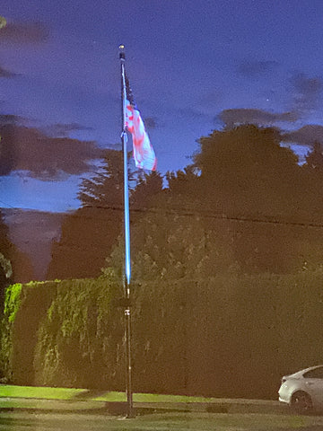 Flagpole lit up at night in Oregon