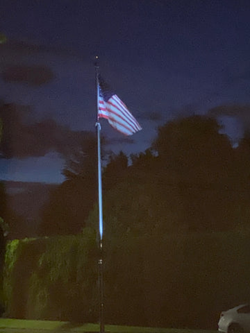 Flagpole lit up at night