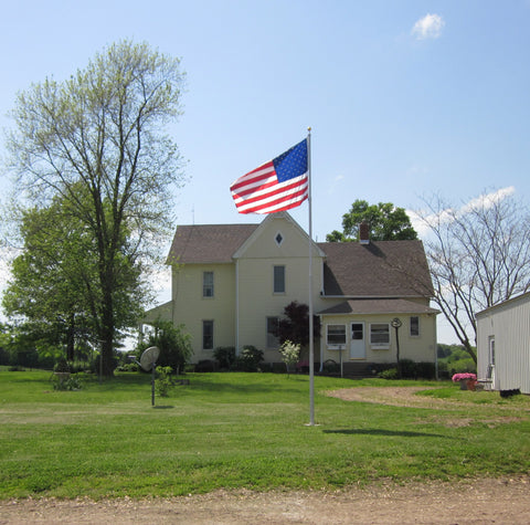20' HD flagpole in front of farmhouse
