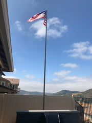 Randy's Flagpole flying in the wind