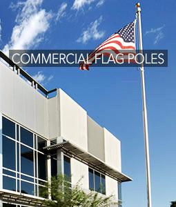 commercial flagpole in front of building