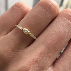 JKD Diamond Marquise baguette equilibrium ring on ring finger