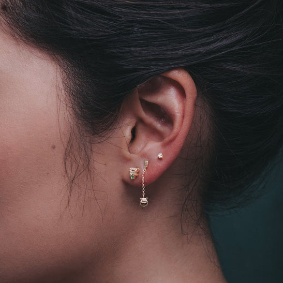 detail, JKD baguette half moon stud on ear