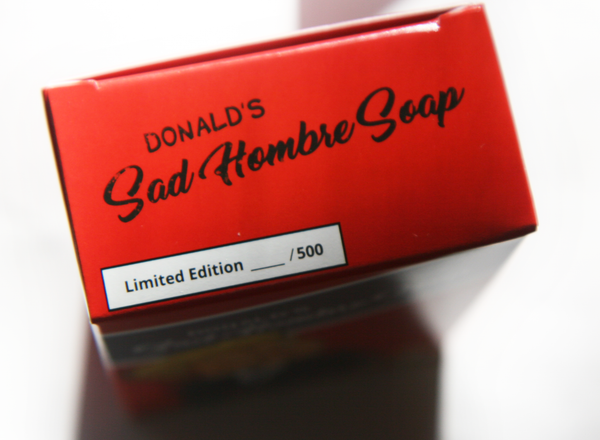 Top of the Limited Edition Nasty Woman Soap: We Got It Wrong packaging. Featuring Nasty Woman Hillary Clinton and Sad Hombre Donald Trump or Bad Hombre Donald Trump.