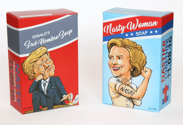 Front of Nasty Woman Soap: We Got It Wrong packaging. Featuring Nasty Woman Hillary Clinton and Sad Hombre Donald Trump or Bad Hombre Donald Trump.