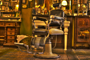 barbers chair in shop woodsman beard company