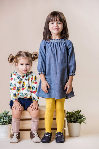 Toddler girls wearing handmade modern smocked clothing by Duchess and goose