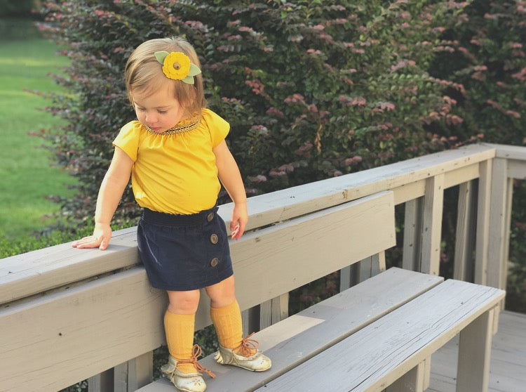 handmade girls smock top in mustard with navy corduroy skirt by duchess and goose