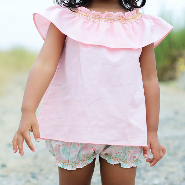 Close Up of pink smock top with gold smocking and unicorn bubble shorts