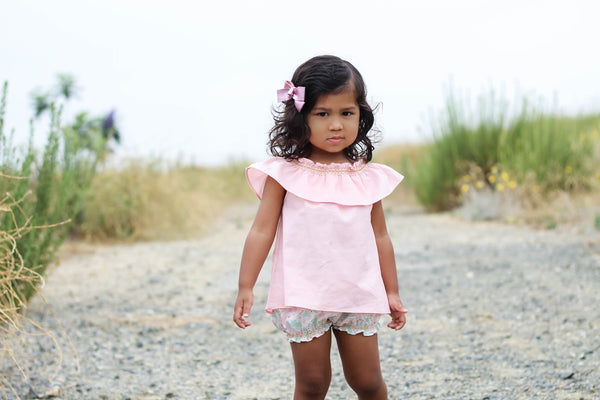 Toddler wearing pink smock top with unicorn bubble shorts by Duchess and Goose